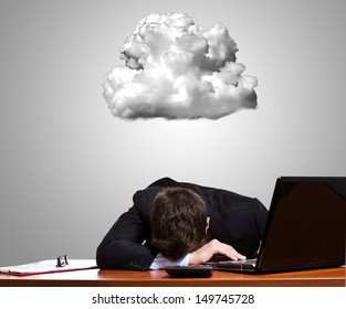 Worried and stressed businessman lying on his desk
