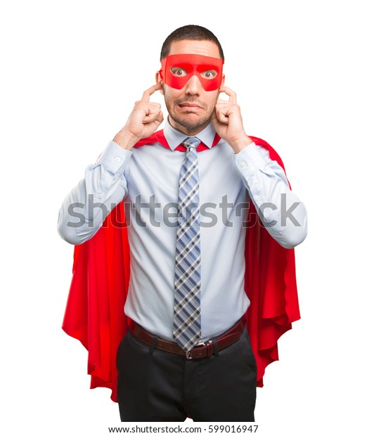 Worried super businessman covering his ears