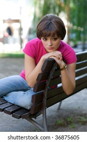 worried teen girl on the bench