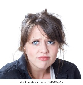 Worried and unhappy head and shoulders portrait of a young woman; isolated on a white background.