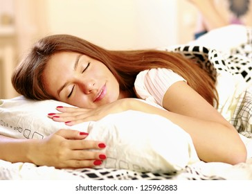 Worried woman in the bed