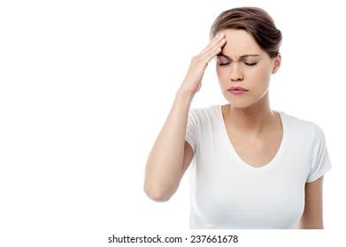 Worried woman feeling the pain in head