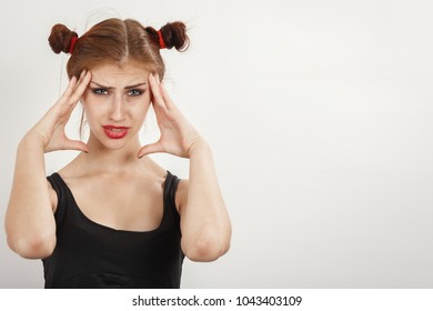 worried woman with hands on her head over white background looking at camera, copy space