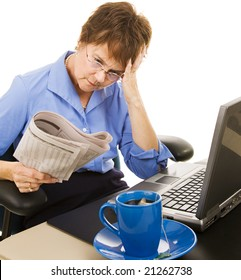 Worried woman reading the stock section of the newspaper.  White background.