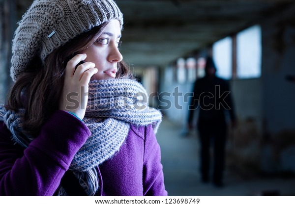 Worried Woman Stalked by a Man