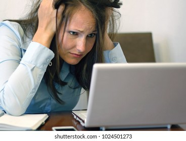 Worried-looking woman with laptop