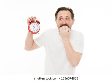 Worry about time. Personal schedule and daily regime. Alarm clock morning time. Man bearded mature guy hold clock isolated on white. Man with beard check what time is it. Time management skills.