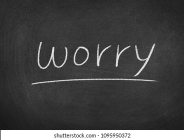 worry concept word on a blackboard background
