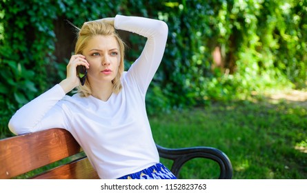 I was worrying about you. Girl blonde tense face talk smartphone green nature background. Woman having mobile phone conversation in park. Girl modern smartphone calling friend cell phone.