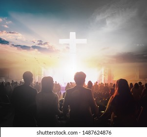 Worship concept: Group of people holding hands praying worship at sunset background