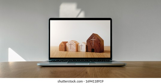 Worship from home, Online live church for sunday service, Laptop screen with wooden cross church photo on wooden table