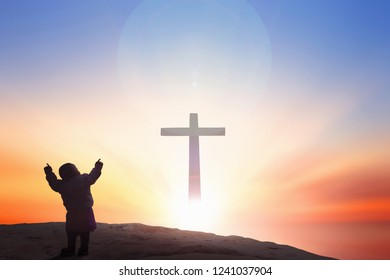 Worship and praise God concept:cross on blurry background