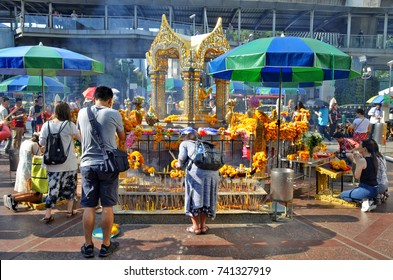 Worshippers at Erawan Shrine in Bangkok. Buddhists worship the four-faced Brahma statue at Erawan Shrine in Bangkok. May 1, 2017.