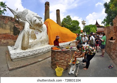 Worshippers at the Reclining Buddha of Wat Yai Chai Mongkhon in Ayutthaya, Thailand - April 14th, 2017