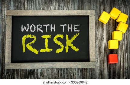 Worth the Risk? written on chalkboard