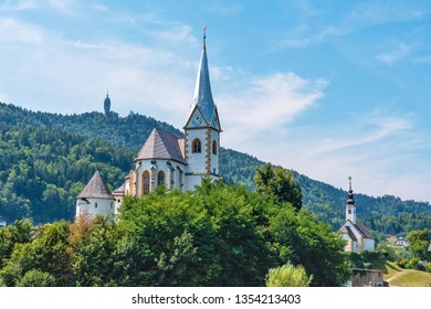 WORTHERSEE, AUSTRIA - AUGUST 08, 2018:  View of the Worthersee lake with Maria Worth church, Carinthia, Austria