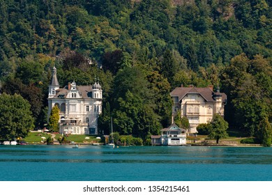 WORTHERSEE, AUSTRIA - AUGUST 08, 2018:  Great scenery from the boat to the shore line of the lake, beautiful buildings, mountains, forests, highways.