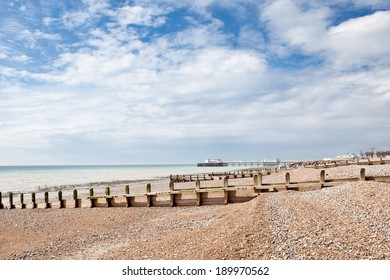 Worthing beach in a cloudy day, low tide, view of the town and beach. South coast, West Sussex, England.