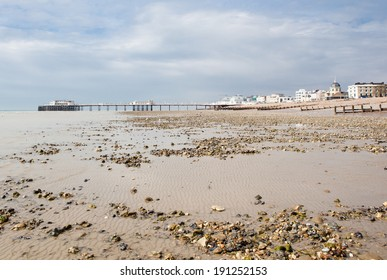 Worthing beach and pier in a cloudy day, low tide.  South coast, West Sussex, England.