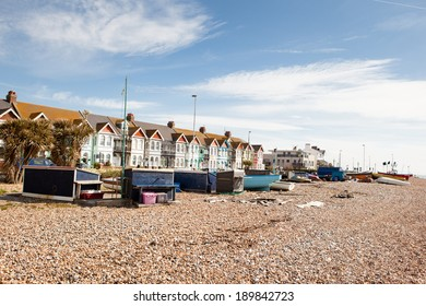 WORTHING, ENGLAND - APRIL 23. Fishing boats and huts on the beach, in Worthing, West Sussex, South England on April 23, 2014