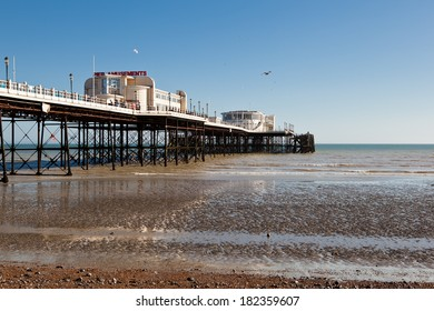 WORTHING, ENGLAND - MARCH 17. People on Worthing pier, West Sussex, England on March 17, 2014