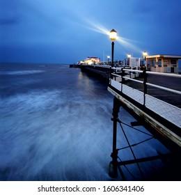 Worthing Pier at night ocean lamp post light