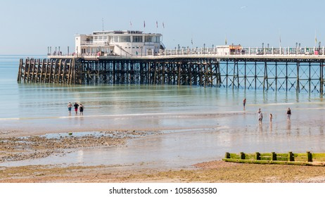 Worthing, Sussex, UK; 18th June 2017; Holidaymakers Paddling at Waters Edge in Sunny Weather With Pier Behind