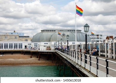 WORTHING, UK - JULY 13, 2019: Worthing pier gets decorated with rainbow flags in support for Gay Pride Parade event