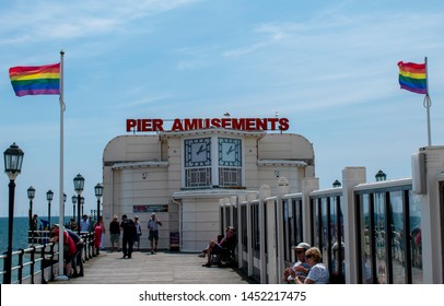Worthing, West Sussex, UK, July 13, 2019, Worthing Pier displaying the Rainbow Flags on the day of the Pride Parade.