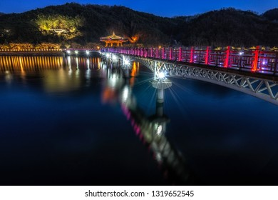 Woryeonggyo Bridge in Andong taken at nighttime. Woryeonggyo is a famous wooden footbridge over the nakdong river. Located in Andong, South Korea.