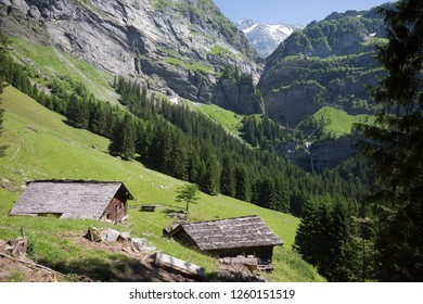 Wouden mountain sheds at Dent du Midi mountains (Champéry, Switzerland)