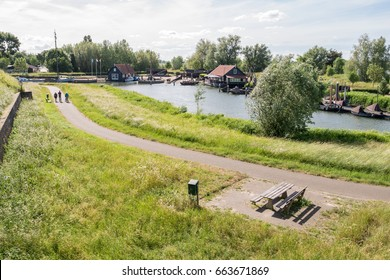 WOUDRICHEM, NETHERLANDS - JUN 4, 2017: Panorama of historic stadshaven from rampart in old fortified town of Woudrichem, Brabant, Netherlands