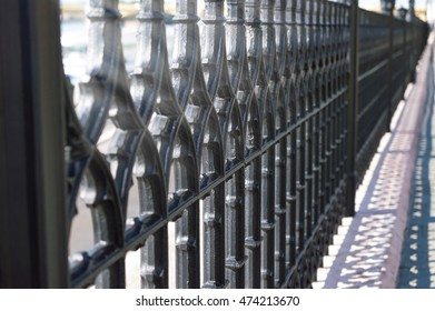 Wought iron fence with repeating pattern