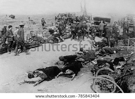 Wounded British soldiers on the battlefield near Ginchy, France, during World War 1 Somme Offensive, Sept. 1916. Irish volunteers of the 16th Division wait for evacuation by horse-drawn ambulance