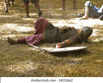 wounded knights lie up on the battle-field