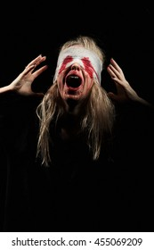 wounded scared bloody girl screaming on black background