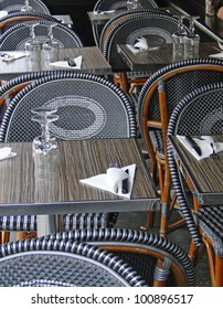 Woven back chairs and tables in a restaurant  Paris, France
