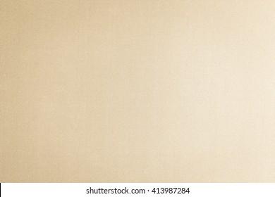 Woven cotton linen fabric textile textured background in light beige cream tan color tone