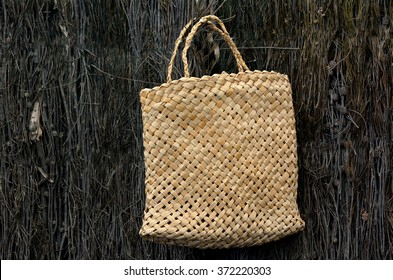 Woven flax bag, a traditional Polynesian Maori culture artwork in New Zealand. No people. Copy space