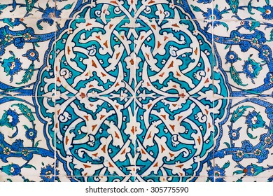 Woven floral patterns with blue flowers on the antique tiles in Ottoman style, made in 16th century for Topkapi palace, Turkey