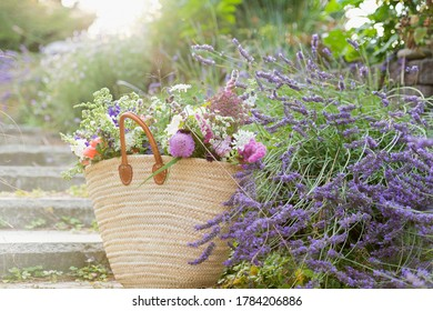 Woven French Style Basket Full of Various Fresh Flowers from Market