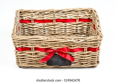 Woven rectangle box,basket with red satin ribbon (tape) and small blackboard. Vintage Christmas decoration box for Christmas and new year, isolated on the white background. Empty basket. Top side view