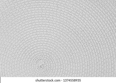 Woven white wicker straw background or texture