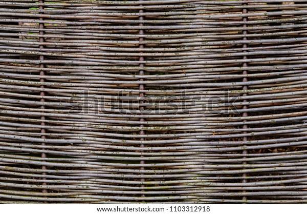Woven wood sticks background.