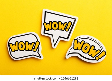 WOW concept speech bubble isolated on yellow background.