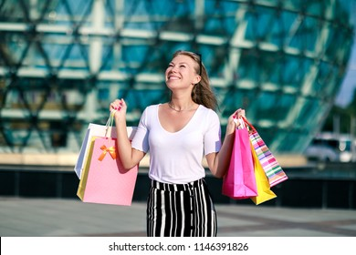 Wow! Final big sale! Shocking prices, surprised girl with shopping bags