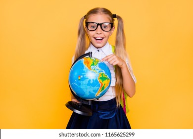 Wow omg I found new continent! Close up photo portrait of funny lovely laughing comic clever smart shocked amazed girl holding sphere in hands isolated on bright vivid color background