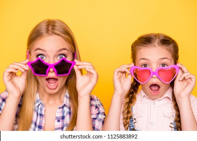Wow omg unbelievable! Close up portrait of cool dreamy friends joy concept. Close up portrait of different aged siblings with funky emotion expressing touching glasses isolated on bright background