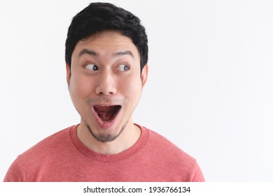 Wow and shocked face of funny Asian man isolated on white background.
