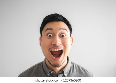 Wow and surprised face of funny good looking Asian man.